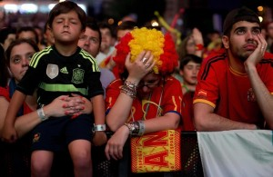 Disappointed Spanish Fans Watch as Spain exits the 2014 World Cup