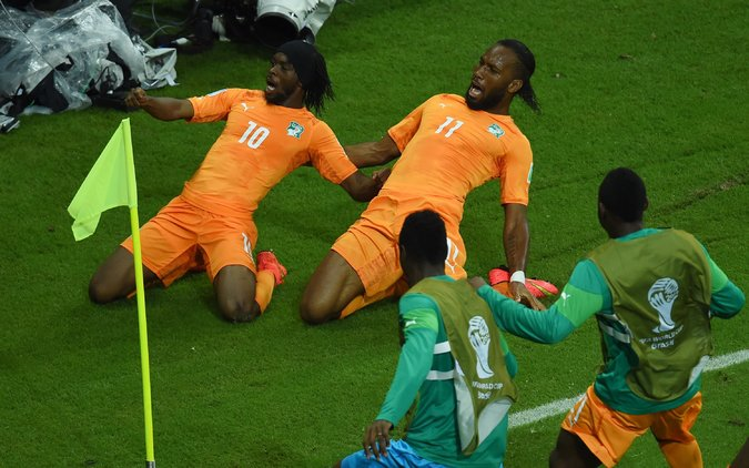 Gervinho and Drogba celebrate