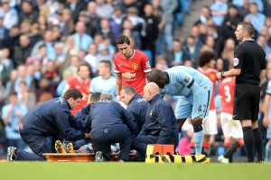 Rojo stretchered off